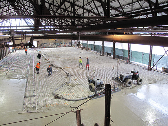 Concrete floor being poured in the kiln building