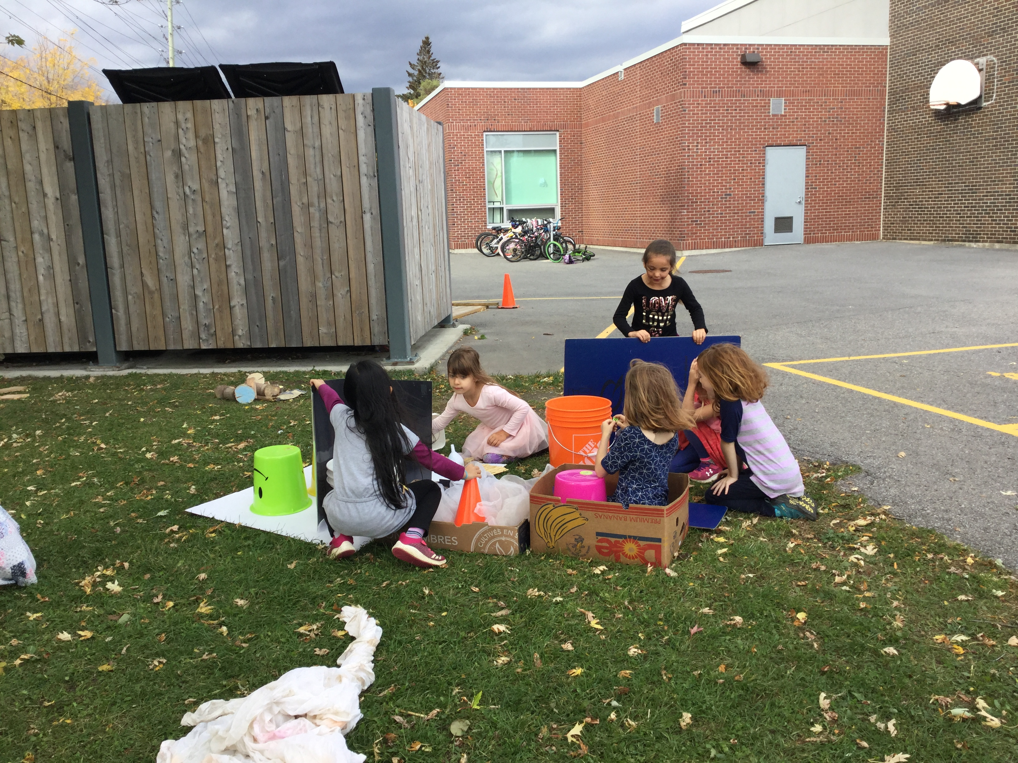 Kids play with loose parts outside.