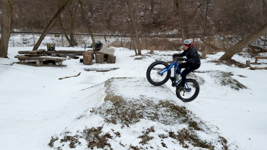 Julia rides a ramp.