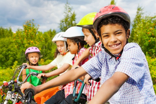 Happy kids riding bikes. Tips on taking active transportation to school and beyond.
