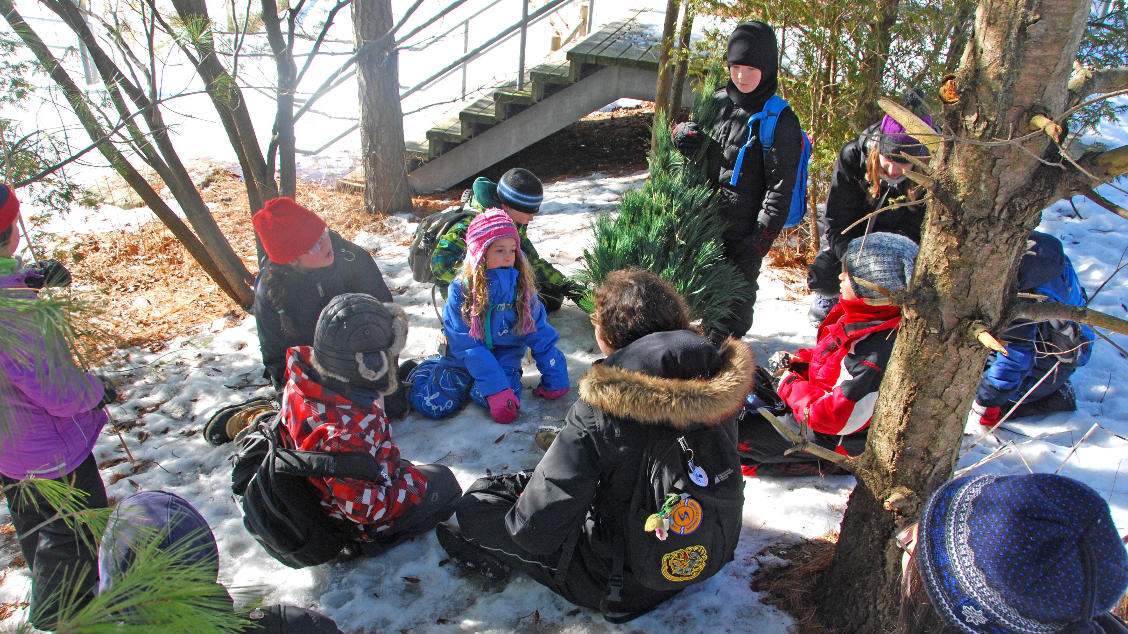 Children play in the Children's Garden in winter.