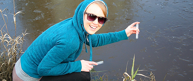 A woman tests water quality.