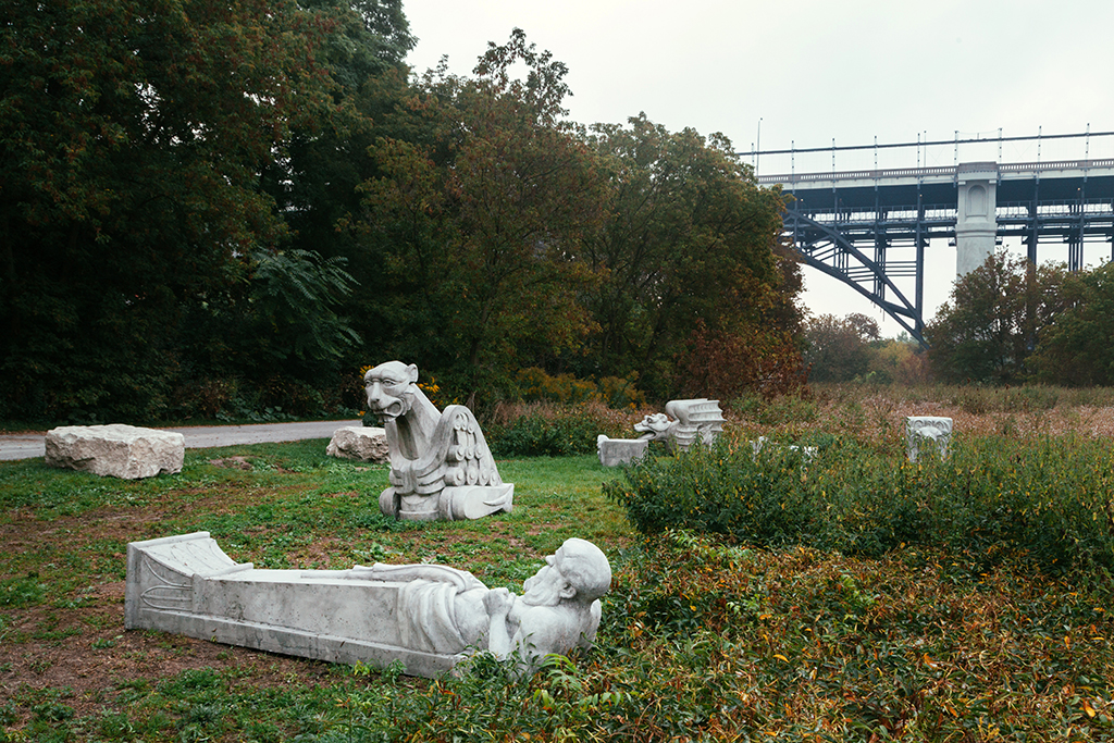 Gargoyle sculptures along a bike trail.