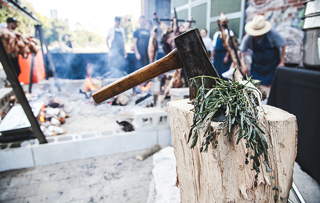 An axe on a log at Evergreen's Asado BBQ in 2015.