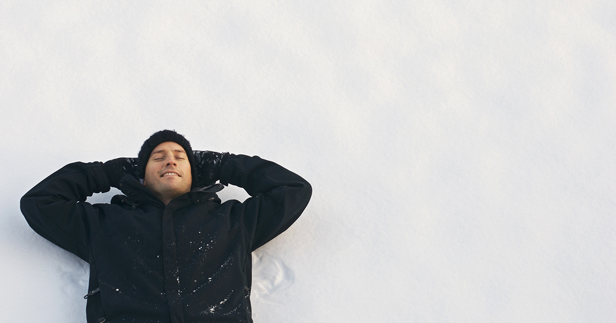 Man laying in snow