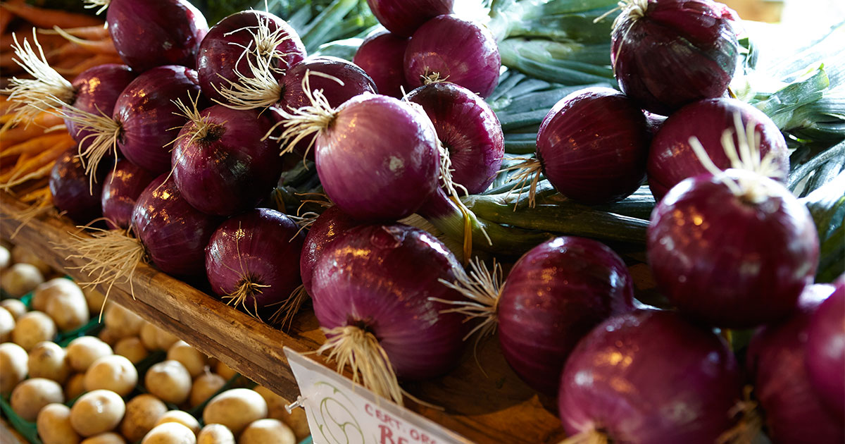 Onions in a basket at the Farmers Market. Image: Mel Yu