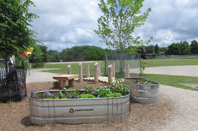 Centennial Public School reimagined their grounds with planters for their students.
