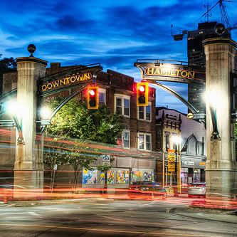 A night view of an intersection at the entrance to downtown Hamilton.
