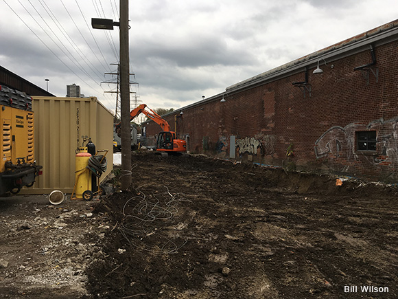 Geothermal construction gets underway just outside the kiln building at Evergreen Brick Works.