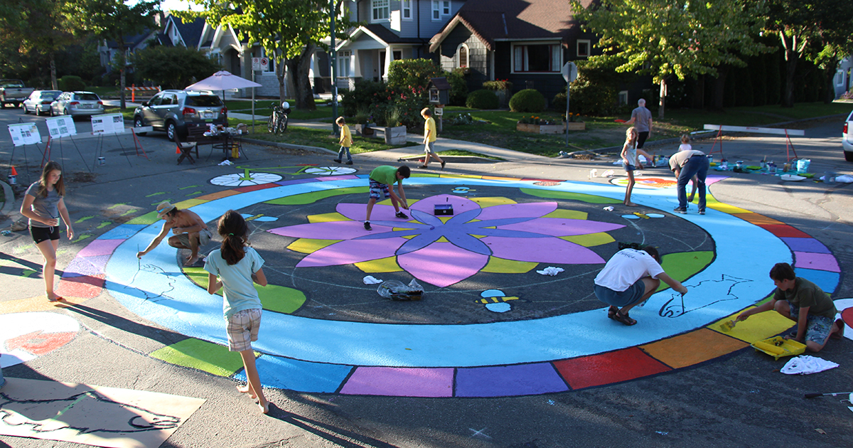 Neighbours help design a mural in Vancouver's Riley Park area.