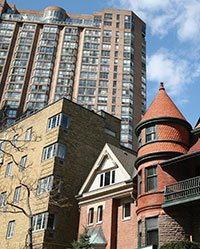 A house, a mid-rise apartment building, and a high-rise apartment building in Toronto.