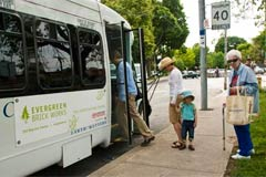 Passengers board the shuttle bus