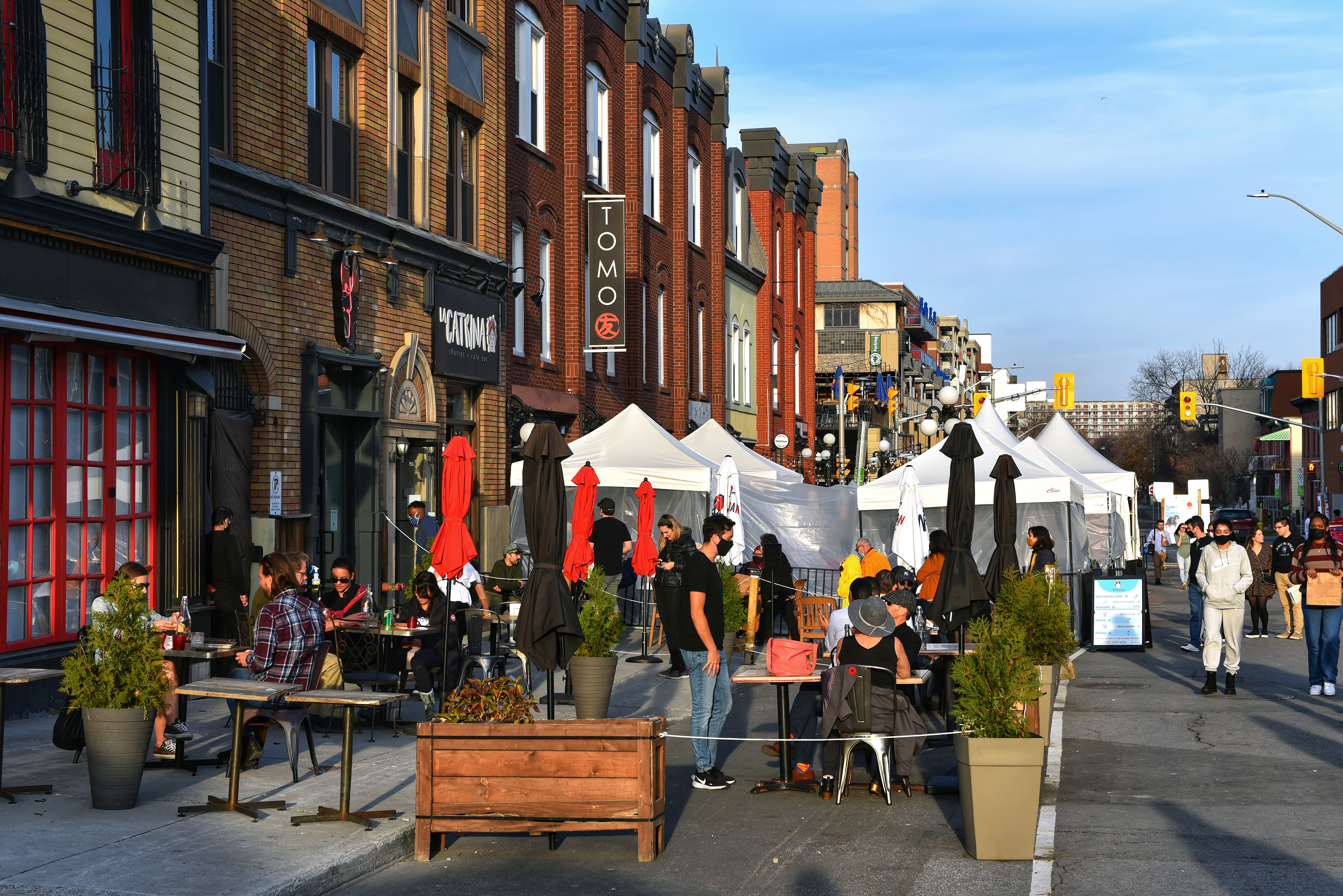 Bars and restaurants on Ottawa's Clarence St. with tents and patios stretching into the street for safe dining.