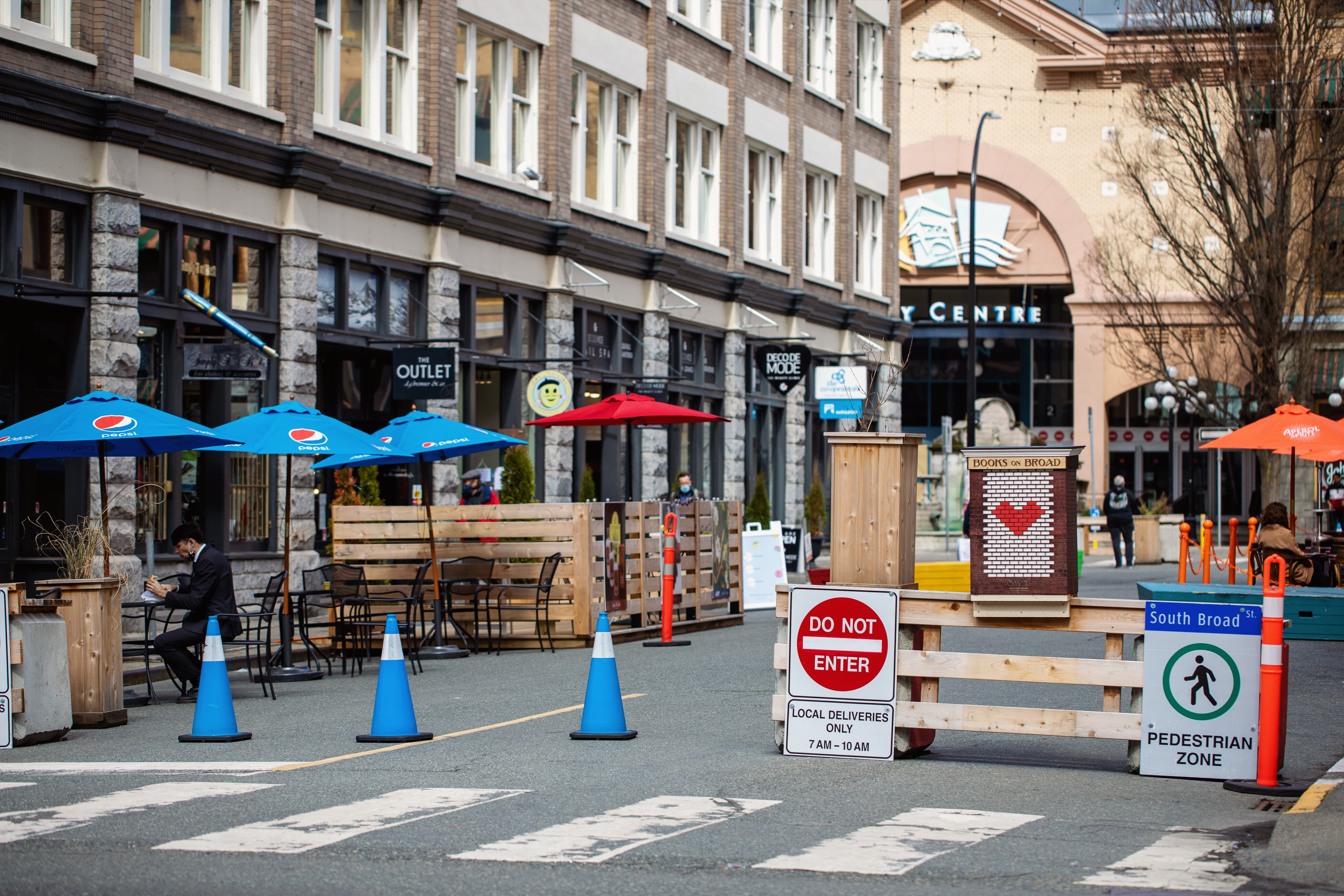 Streets in Victoria, BC closed off for pedestrian use and sidewalk cafes.