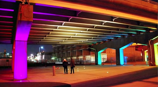 Underpass park lighten up with coloured lights at night.