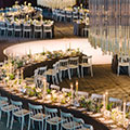 A long table set for a wedding dinner in the kilns at Evergreen Brick Works.