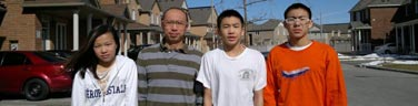 Volunteers Edward Chan and his three teenage children.
