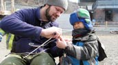 Camp counsellor Brian shows a camper how to make cordage. Photo: Michelle Laporte.