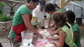 Volunteers show some kids how to make pizza. Photo: Michelle Laporte.