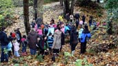 Brentwood Elementary students watching the planting demonstration at Beecher Creek. Photo: James Atwater.