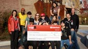 Evergreen staff, Y Academy Eco-Ambassadors and Geoff Cape accept a cheque from the State Farm YAB.