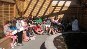 Students at Mapleton read in their outdoor classroom.