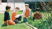 Students investigate plants in their outdoor classroom at Cassandra P.S. Photo: Evergreen.