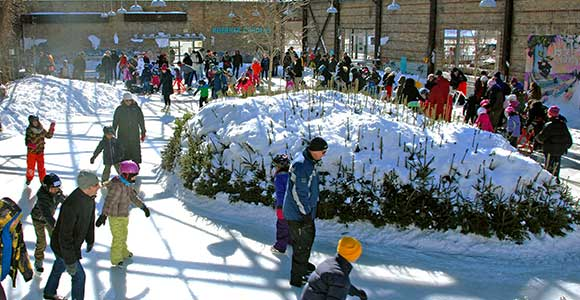 People skating at the Evergreen Brick Works Skating Rink